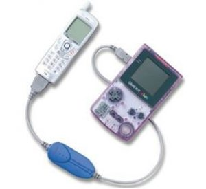 Press image of a Mobile Adapter GB connected to a Game Boy Color.